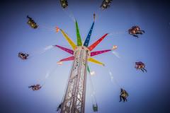 Going Round in Circles (Robert Bauernhansl) Tags: pink blue red sky green rot colors yellow linz austria sterreich ride rosa gelb spinning grn blau funfair bunt jahrmarkt drehen fahrgeschft