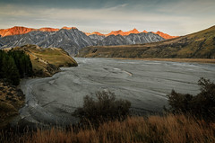 The sun kisses the hills (dave.fergy) Tags: red newzealand sun mountain water river landscape dawn countryside stream canterbury nz erehwon ashburtonlakes on1pics