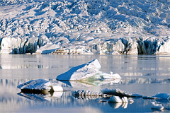 In Transition..... (scott morgan images) Tags: snow mountains clouds sunrise reflections iceland east iceberg glaciallagoon glacialtongue scottmorgan glacialice vatnajkullglacier scottmorganimages latestuploadsflickr