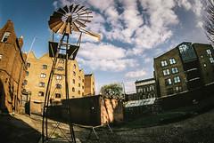 Wind catcher (Subway eg) Tags: windows sky house mill film windmill metal clouds buildings daylight nikon day wind bricks fisheye fujifilm 16mm zenitar nikonf5 club16 zenitar16mmf28london