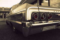 '64 SS (Explored 4/05/2012) (Flint Foto Factory) Tags: auto park city urban bw white chicago black color classic chevrolet car sepia vintage emblem illinois spring 60s automobile gm view parking ss rear north perspective broadway lot convertible chevy bumper chrome american april faux intersection 1960s impala norwood edgewater taillights 1964 ragtop 2012 selective fullsize colorization generalmotors hrblock 2door glenlake threequarter droptop slowride worldcars bbody