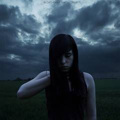 Self Strangulation (CatherineMacgeorge) Tags: portrait sky cloud selfportrait storm girl field rain weather self dark death pain hurt alone moody sad atmosphere pale strangle concept conceptual stormcloud enemy suffocate darkhair twighlight paleskin