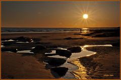 GETTING THE LAST SHOT (ninja nan1) Tags: uk light sunset sun beach silhouette wales reflections nikon rocks glow pools southerndown d300s