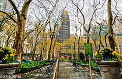 Bryant Park, New York (KP Tripathi (kps-photo.com)) Tags: newyorkcity newyork rain cityscape timessquare empirestatebuilding bryantpark     canoneosmarkiii newyorkcityandmanhattan    thnhphnewyork      kptripathi canoneos24105f4lis