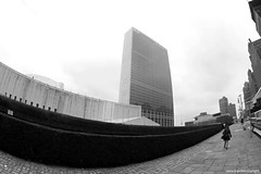New York - United Nations building (secretariat) (JanvanSchijndel) Tags: world street city travel light sky bw woman white newyork black building art nature lines stone set architecture composition contrast canon geotagged person interesting focus exposure day peace view unitedstates angle bokeh pov details famous country ngc perspective culture visit location fisheye communication explore un international unitednations info information geotag league global 10mm admosphere
