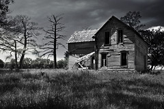 Whispers in the Wind (TumblingRun) Tags: old bw house abandoned nikon decay iowa haunted prairie baretrees hss d90 allhellbreaksloose