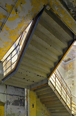 beneath the stairs (Jonathon Much) Tags: urban usa chicago abstract building abandoned industry geometric broken colors yellow metal architecture stairs canon vintage concrete illinois rust industrial shadows geometry decay sears urbandecay debris rusty indoors staircase urbanexploration american rusted rusting peelingpaint aging functional crusty cracked decayed decaying cracking cascading antiquated urbex decomposing disintegrating searsbuilding canon7d