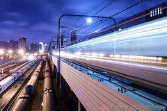 Train speed in Shanghai (vip2014) Tags: china road city railroad travel bridge light urban abstract motion blur public lamp lines station night speed train dark drive evening construction long exposure track shanghai traffic dusk background transport perspective fast rail railway blurred move illuminated viaduct trail transportation commute vehicle commuting through  elevated  rapid luminous speeding  overpasses
