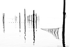Fishing nets (Johan Konz) Tags: blackandwhite monument netherlands monochrome fishing outdoor whitebackground nets afsluitdijk