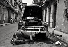 Street mechanic (bananacake1000) Tags: havana cuba classiccar streetphotography candid blackandwhite nikon d7200 photojournalism travel