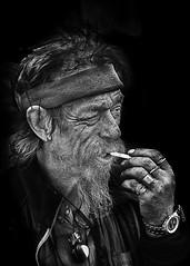 Portrait (D80_444445) (Itzick) Tags: man face blackbackground copenhagen denmark cigarette candid watch smoking rings d800 itzick