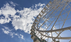I believe I can touch the sky (Christian Ferrari) Tags: city blue light sky sun white wheel architecture clouds panoramic
