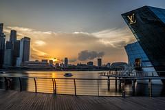 Louis Vuitton Singapore sunset (jh_tan84) Tags: longexposure blue sunset sky orange water clouds landscape singapore lv louisvuitton marinabaysands