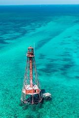 Beware of shallows (agruebl) Tags: blue sea lighthouse color fuji florida marathon aerialview blau reef leuchtturm floridakeys luftaufnahme shallows shallowwaters fujixt1 sombrerokeylight
