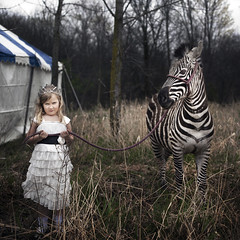 Lucy and Sura (Rob Woodcox) Tags: blue trees white girl field forest dark dress princess circus meadow surreal tent zebra crown meaning northridge whimsical clearing upset familycircus northridgechurch robwoodcox robwoodcoxphotography