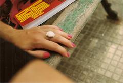 banco. (~gciolini) Tags: brazil mamiya film colors brasil analog 50mm book banco ring read livro gabriela anel cfa analogic analgico caiofernandoabreu caiof oovoapunhalado ciolini colornegative100 gciolini beanalog
