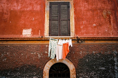clean cloth # 2 (michel nguie) Tags: street door light red people italy holiday color roma art film beauty wall analog 35mm landscape photography photo holidays poetry italia photos kodak streetphotography scroll gonzo carlzeiss  fnykpezs michelnguie mitchunderground