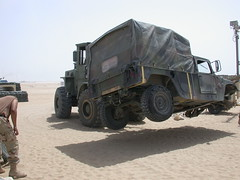 How Army Dentists change a flat tire on a Humvee in the desert (DrBrianHale) Tags: city tooth army pain war lift flat military teeth iraq fork tire tent company health change kuwait humvee dentist base dentistry supply