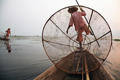 Traditional Fishing - Inle Lake, Myanmar (Maciej Dakowicz) Tags: sunset sea lake classic net water work boat fishing fisherman asia southeastasia fishermen burma traditional scenic myanmar inlelake inle burmese