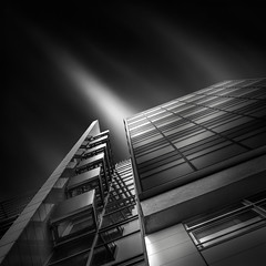 a path to the sky III - stroke of light (Julia-Anna Gospodarou) Tags: city longexposure sky urban blackandwhite bw building berlin tower monochrome architecture clouds germany square daylight nikon tripod perspective le photowalk tall streaks tamron highlight 2012 upwards manfrotto modernbuilding hoya curtainwall glasswall blacksky nd400 balconnies manfrotto055xprob bw106 nikond7000 googlegoogleplus juliaannagospodarou europhotowalk wallclodding siruik20x tamronaf18270mm3563pzd