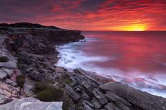Cape Solander, Sydney (stevoarnold) Tags: sunset red sea clouds sunrise rocks sydney australia cliffs burning nsw capesolander