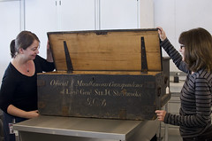 Staff members open one of the storage boxes from the Sir John Coape Sherbrooke fonds / Des employes ouvrent lune des botes de rangement du fonds Sir John Coape Sherbrooke (BiblioArchives / LibraryArchives) Tags: canada quebec box lac storage staff qubec gatineau bac libraryandarchivescanada bibliothqueetarchivescanada sirjohncoapesherbrooke preservationcentre centredeprservation employes botederangement
