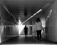 Tunnel (tuti_s11) Tags: shadow men london subway women candid streetphotography tunnel scooter londres lightshadow streetshot blackwhitephotography candidphotography nikond810 bnwphotography