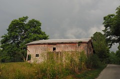 An Indiana Barn (Plummerhill) Tags: road trees sun clouds barn fence weeds pasture countryroad ruraldeterioration