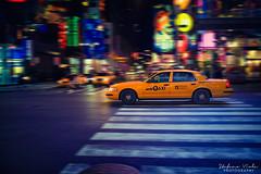 Streets of New york (Stefano Viola) Tags: nyc travel people usa newyork cars colors yellow advertising lights skyscrapers traffic manhattan taxi broadway timessquare posters luci viaggio citt 7thavenue nuances sfumature grattacieli settimastrada