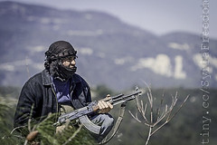 A member of the Free Syrian Army takes positio...