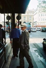 window shopping, by J L Sinclair (Jelausin) Tags: street city people man paris slr 35mm photography minolta documentary
