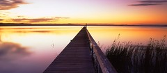 Long Jetty Dusk light (Mark Wassell) Tags: new sunset lake seascape reflection water wales reeds coast long glow jetty south central lakes entrance australia nsw the tuggerah