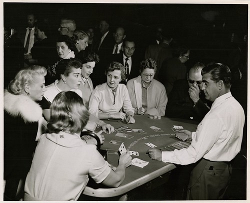 Photograph of gamblers at the blackjack by UNLV Libraries Digital Collections, on Flickr