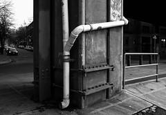 Column reinforced after the 2001 earthquake, Seattle (Blinking Charlie) Tags: seattle urban blackandwhite bw usa blackwhite washingtonstate drainpipe lightandshadow pioneersquare alaskanwayviaduct 2011 2001earthquake seismicdamage swashingtonstreet canonpowershotg12