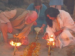 "Vamadeva Shastri and Yogini Shambhavi lighting the Aarati lamps at the Ma Ganga Yoga Shakti retreat • <a style=""font-size:0.8em;"" href=""http://www.flickr.com/photos/80108875@N05/7362180368/"" target=""_blank"">View on Flickr</a>"