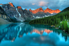 Moraine Lake Sunrise Colorful Landscape (tigercop2k3) Tags: park morning travel blue red summer lake canada mountains reflection tourism nature water beautiful rock clouds forest sunrise landscape rockies scenery colorful aqua outdoor hiking turquoise famous scenic deep rocky vivid peaceful can canadian calm alpine national alberta serenity summit destination banff peaks lakelouise pure emerald tranquil moraine attraction banffnationalpark pristine