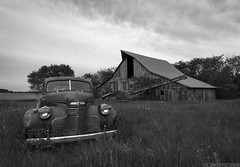 Untouched (Erik Johnson Photography) Tags: wood old windows sky bw white black green classic chevrolet abandoned car metal clouds barn photography lights photo rust midwest nebraska doors antique farm farming pasture prairie