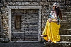 In the Spotlight (TranceVelebit) Tags: croatia dalmatia brac bra pucisca puia stone limestone street streets old town urban woman croatianwoman dress yellow contrast light portrait posing adriatic jadran sitting