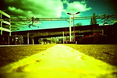 On the yellow line (Cloni) Tags: film station yellow clouds train lca xpro lomography analogue elitechrome xprocessing exb