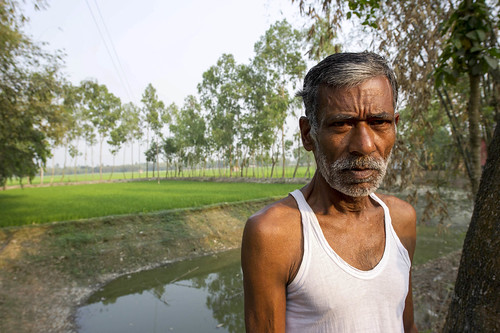 Man with his aquaculture pond and rice field, Bangladesh. Photo by Finn Thilsted, 2012