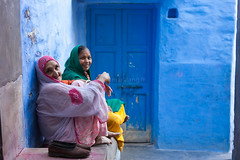 Blue, Jodhpur (Marji Lang) Tags: door old travel blue friends two portrait people woman india color home colors azul composition photography women colorful colours image indian bleu blau couleur rajasthan jodhpur saris streetshot rajasthani jodhpurblue marjilang