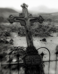 West Texas Cross (squint photo) Tags: cemetery graveyard headstone nikonn80 fineartphotography cemeteryphoto catholiccross sonjaquintero squintphotography graveyardphoto westtexasghosttown