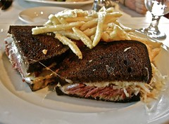 Reuben Sandwich with Fries (ricko) Tags: food lunch restaurant swisscheese plate sauerkraut frenchfries sandwich meat kansascity reuben ryebread chaz cornedbeef thousandislanddressing raphaelhotel