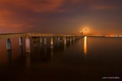 sous la lune (Cani Mancebo) Tags: sea españa orange moon marina lune landscape spain nocturnal paisaje luna explore murcia nocturna naranja longexposuretime largaexposición sanjavier santiagodelaribera explored canimancebo