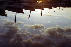 Belső tó Tihany (.e.e.e.) Tags: lake reflection film water clouds analog boat hungary olympus explore mf analogue zuiko manualfocus balaton filmscan olympusom10 olympusomsystem zuiko1850 epsonv350photoscanner expiredin2003maxellxl100colournegativefilm