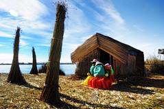 Living on reed islands of Lake Titikaka (beyondhue) Tags: life travel lake color peru reed uros titicaca island women day dress bright floating sunny textile hut tribe titikaka 2012 beyondhue