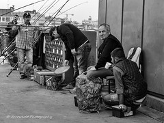 Street 120 (`ARroWCoLT) Tags: street old bridge light bw white fish man black monochrome underground photography blackwhite fishing chair waiting sitting low samsung istanbul line sit fisher f2 beyaz horsemackerel galata karaky sokak siyah balk istavrit nx300
