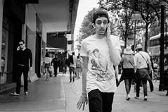 sting like a bee (jonron239) Tags: boy man london walking expression fingers tshirt smartphone boxer gesture talking oxfordstreet geezer muhammadali baseballcap