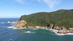 Knysna Heads (Rckr88) Tags: ocean africa travel sea cliff mountains green nature water southafrica outdoors coast south cliffs coastal greenery coastline gardenroute knysna westerncape rockycoastline knysnaheads