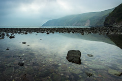 Lynmouth (jon.capps) Tags: ocean uk morning sea summer storm beach water canon relax puddle still rocks tripod salt calm atlantic devon slowshutter rest lynmouth manfrotto northdevon cablerelease 1740mmf4 nd06 60d ndgrads canon1740mm14lusm